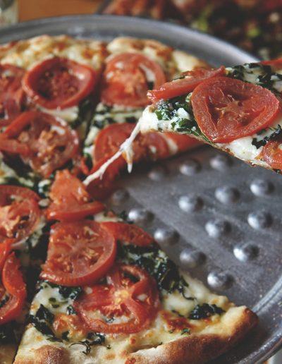 Margherita pizza slice on spatula
