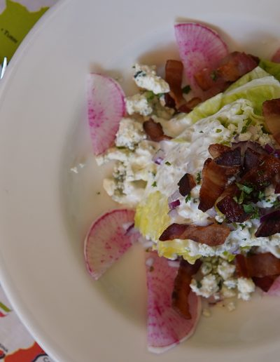 Wedge salad on white plate